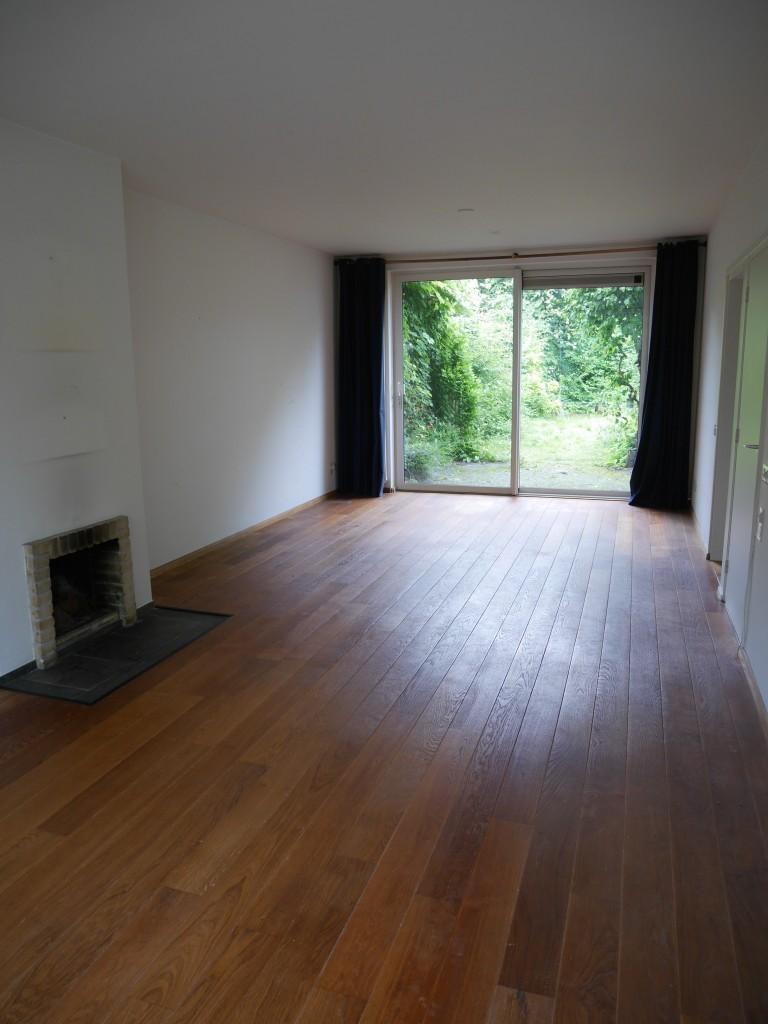 Houten vloer woonkamer lakken